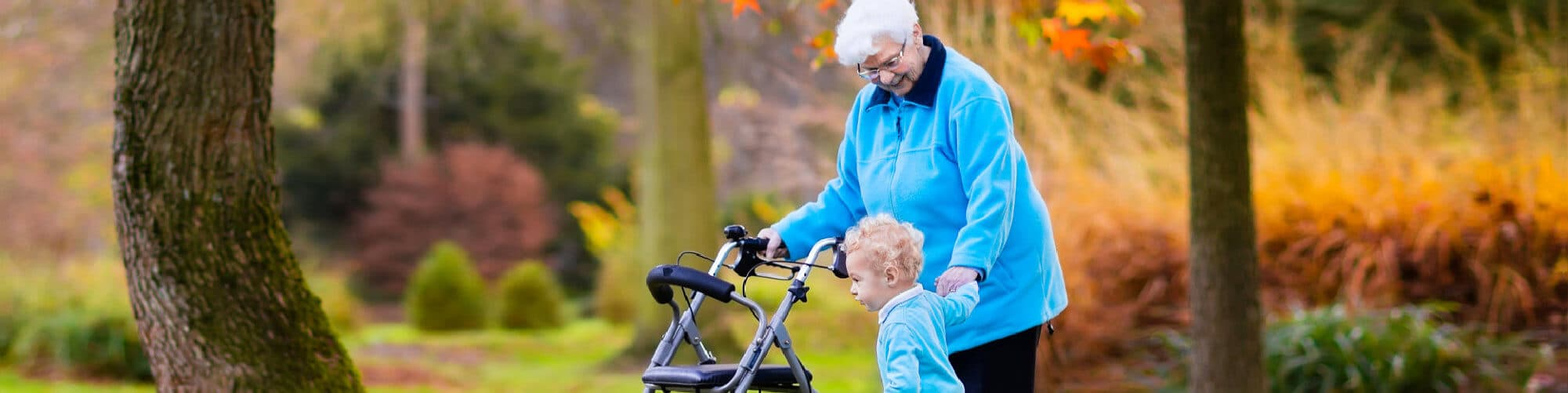 Elderly Woman with baby at hte park