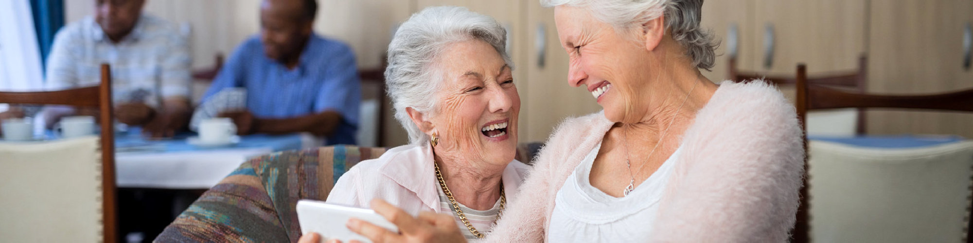 Two old woman laughing
