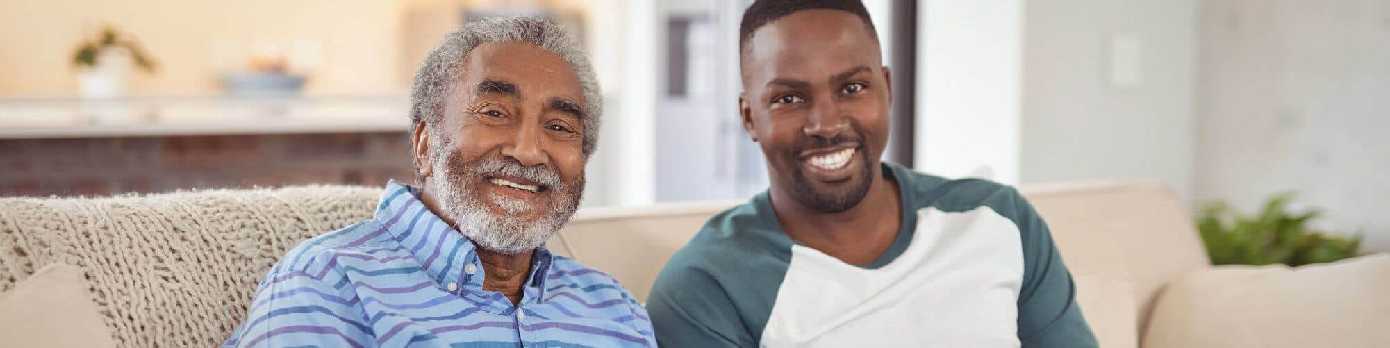Elderly Man and his son smiling