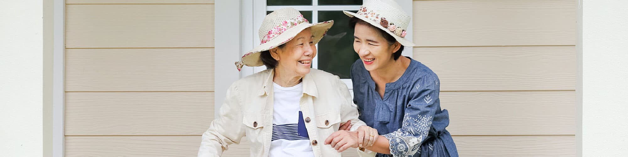 Two elderly woman laughing