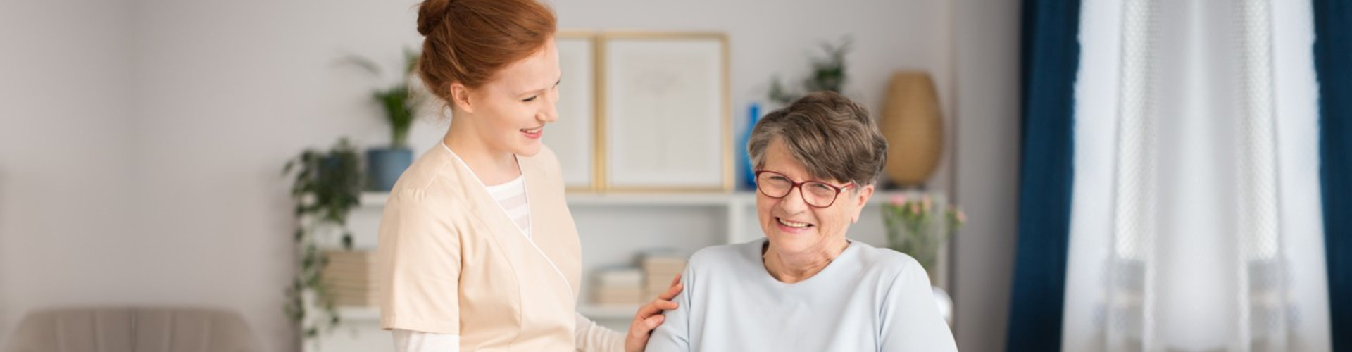 famale caregiver and senior woman are smiling