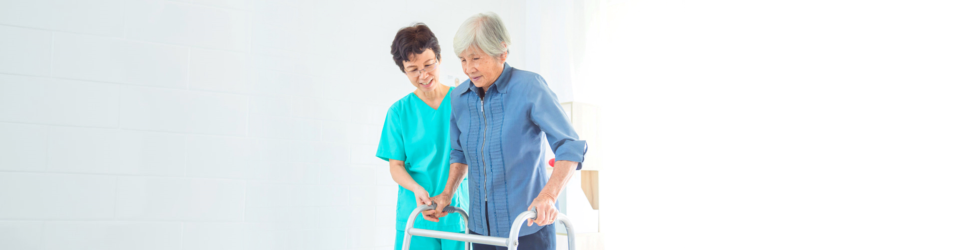 female caregiver assisting to her patient to walk