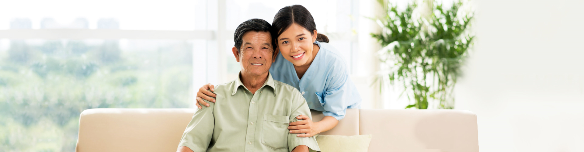 asian caregiver and her old man patient